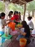Making lemonade for the villagers who are waiting to receive eyeglasses.