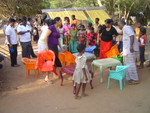 Mihiri and Charlini bringing new chairs and desks for the children.