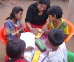 Dr. Niranjala Tillakaratne, advisory board Empwer a village, working with children