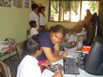 Mihiri and volunteers working with chilren in the special-education classroom, donated by Empower A Village Inc.