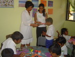 Charlini and Lalindika, Empower a Village volunteers working with special education children