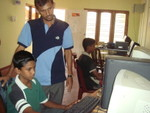 The  Kapuliyadda computer teacher with two of his students.